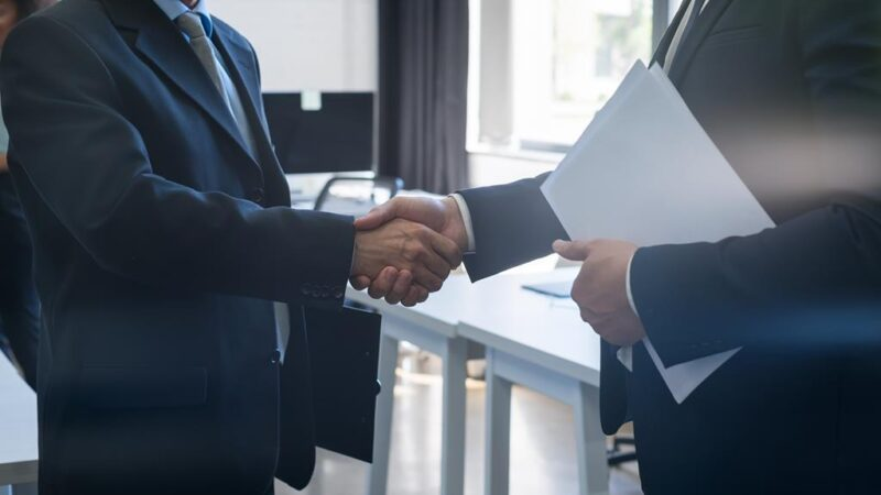 two-unrecognizable-business-man-shake-hand-agreeme-63J9V7E
